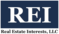 Real Estate Interests LLC